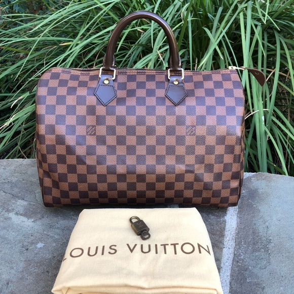 d097e5a577fd Louis Vuitton Handbags - 💯LV Damier Ebene Speedy 35  W DUST BAG
